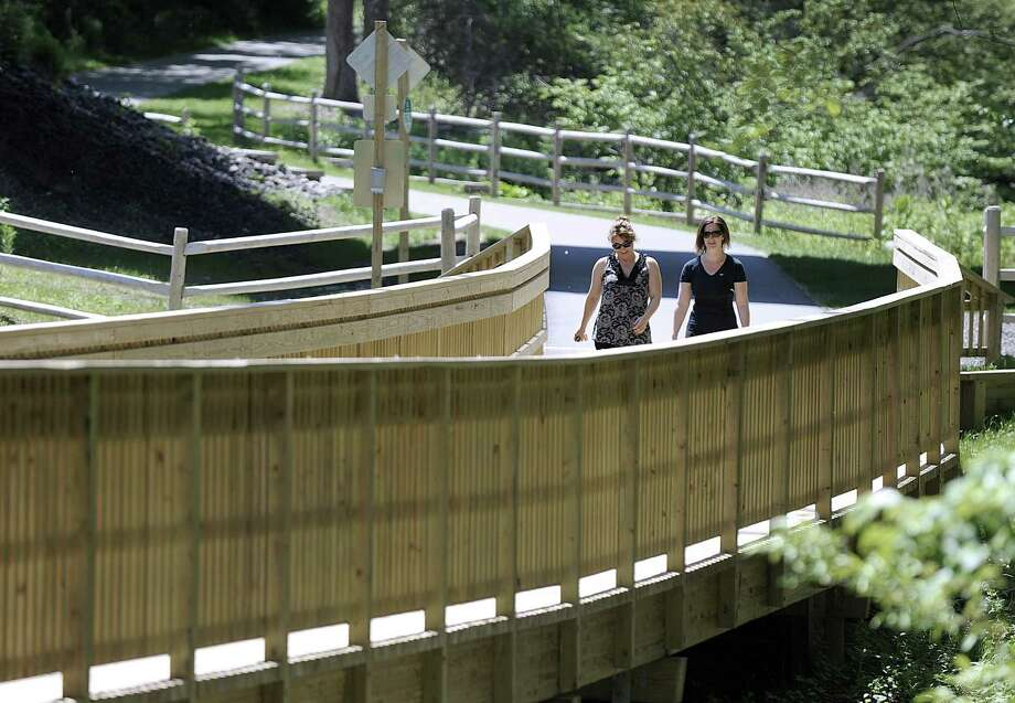 Racquel DiTullio, left, of Brookfield, and her sister, Koren Evans of New Milford, take a walk on the Still River Greenway in Brookfield, Friday, June 2, 2017. Photo: Carol Kaliff / Hearst Connecticut Media / The News-Times