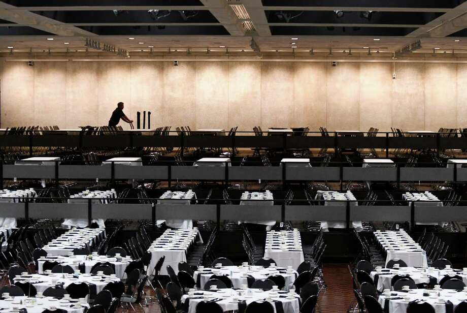 Tables are set for the Black and Puerto Rican Caucus at the Empire State Convention Center on Friday, Feb. 15, 2019, in Albany, N.Y. The 48th annual legislative conference for the NYS Association of Black and Puerto Rican Legislators began Friday. (Will Waldron/Times Union) Photo: Will Waldron, Albany Times Union / 40046218A