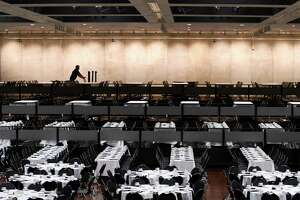 Tables are set for the Black and Puerto Rican Caucus at the Empire State Convention Center on Friday, Feb. 15, 2019, in Albany, N.Y. The 48th annual legislative conference for the NYS Association of Black and Puerto Rican Legislators began Friday. (Will Waldron/Times Union)
