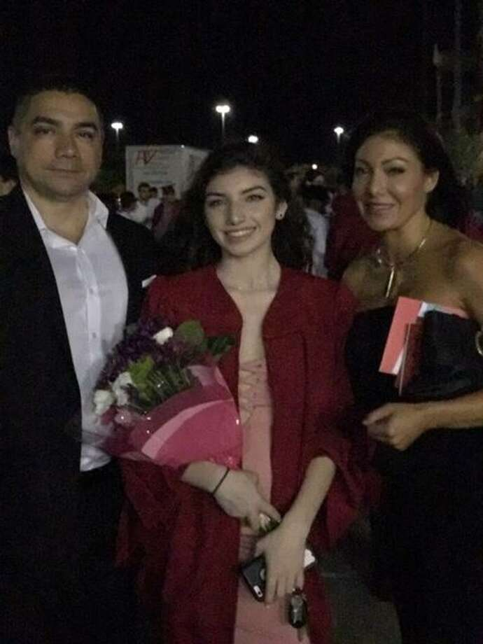 Alanna Luengas stands with her parents,Jade James and John Luengas, at her high school graduation on May 17, 2017. Photo: Jade James And John Luengas