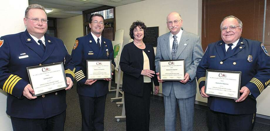 South Fire District Deputy Chief Steven Krol, then-Middletown Fire Chief Robert Ross, former Police Chief J. Edward Brymer and former Deputy Chief Burt Hale of the Westfield Fire District join former Mayor Domenique Thornton in showing off awards they received from the Connecticut Association of Public Schools Superintendents in this file photo from May 29, 2002. Photo: Tom Warren / File Photo
