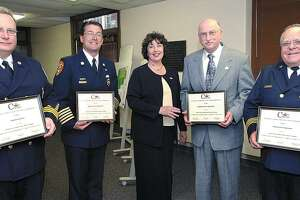 South Fire District Deputy Chief Steven Krol, then-Middletown Fire Chief Robert Ross, former Police Chief J. Edward Brymer and former Deputy Chief Burt Hale of the Westfield Fire District join former Mayor Domenique Thornton in showing off awards they received from the Connecticut Association of Public Schools Superintendents in this file photo from May 29, 2002.