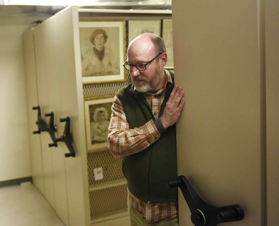 Curator of Library and Archives Christopher Shields peeks out from within the archive vault at the Greenwich Historical Society in the Cos Cob section of Greenwich, Conn. Tuesday, Jan. 29, 2019. The library and archive contain nearly 20,000 linear feet of historical materials, including upwards of 40,000 prints and maps. Photo: Tyler Sizemore / Hearst Connecticut Media / Greenwich Time