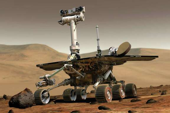 FILE -- An image provided by NASA shows an artist's rendering of the Opportunity rover on the surface of Mars. The rover, which landed in January 2004, was designed for 90 days of exploration but remained functional for more than 5,000 Martian days. (NASA via The New York Times) -- EDITORIAL USE ONLY --