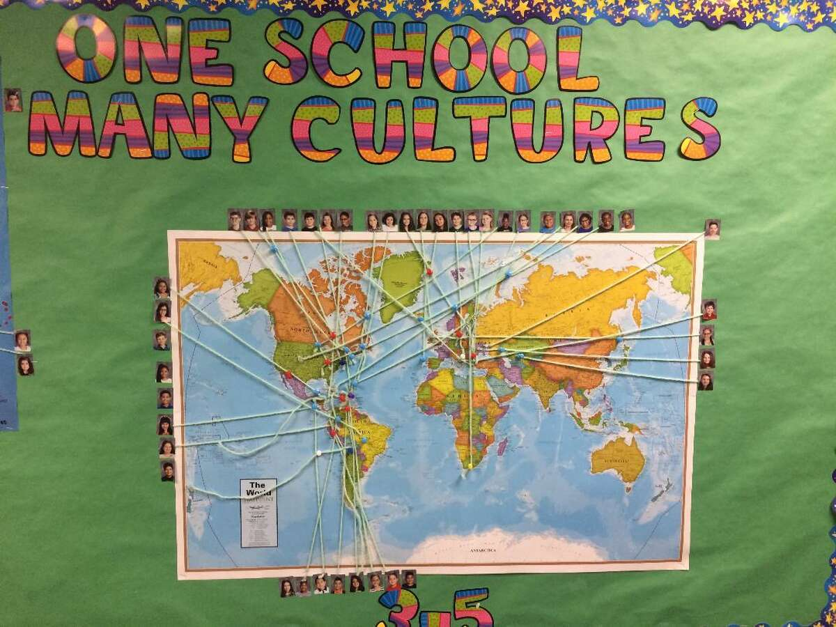 A world map at Derby's Irvin School shows the ethnic background of some of its third through fifth graders as a way to promote inclusivity.