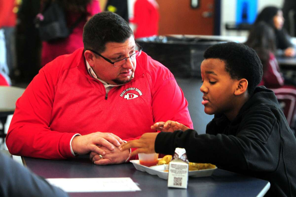 Dean of Students Marc Russo speaks with 6-th grader Ken Little during the