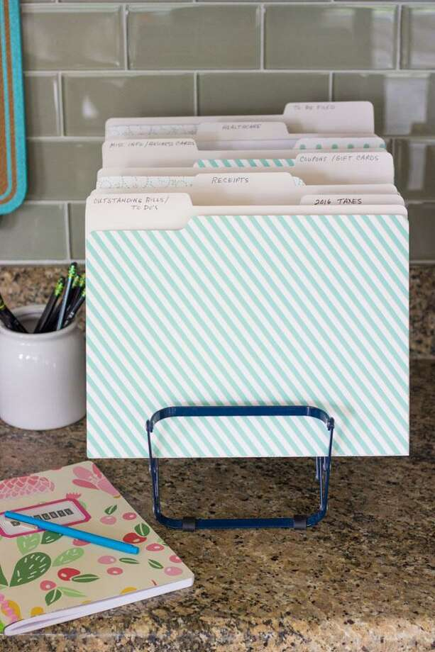 File folders organized in an expandable file rack can be an effective organizing tool. Photo: Courtesy Photo