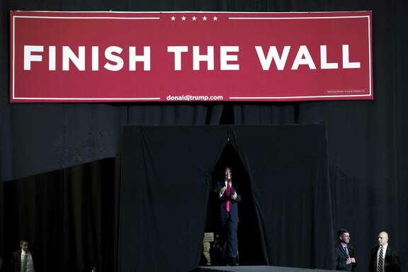 President Trump arrives to speak at a rally in El Paso, Texas, Monday. Trump came to this bustling border city to rally support for his wall with Mexico while Beto O'Rourke, led the city's residents in his own boisterous show of opposition. Readers debate the wall.