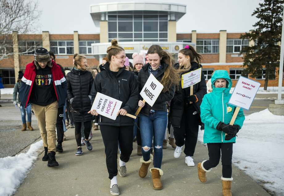 Midland High students, along with members of WOMAN (Women of Michigan Action Network), MHS staff and community members walk outside during a One Billion Rising event in support of women across the globe who suffer domestic abuse on Friday, Feb. 15, 2019. (Katy Kildee/kkildee@mdn.net) Photo: (Katy Kildee/kkildee@mdn.net)