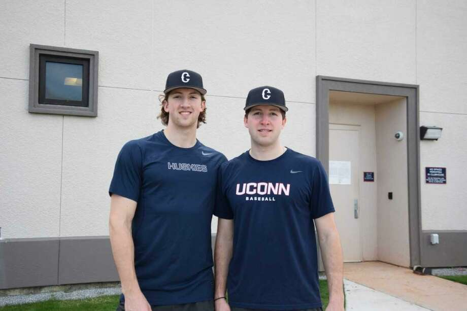 Chris Winkel, left, and his younger brother Pat Winkel will be UConn's starting first baseman and catcher, respectively, this season. Photo: UConn Athletics