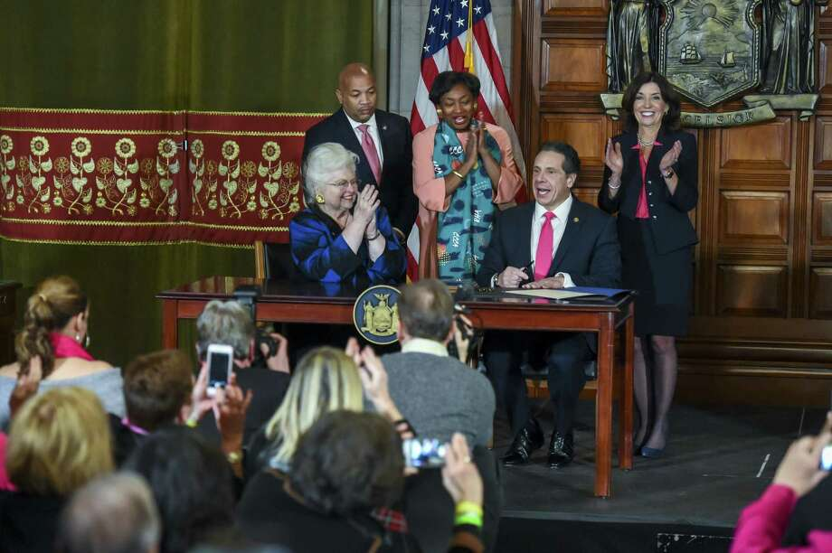 Gov. Andrew Cuomo signs the Reproductive Health Act, expanding abortion rights, at the State Capitol in Albany, N.Y., Jan. 22. The Queens district attorney, Richard Brown, cited the Reproductive Health Act as the reason for dropping an abortion charge against a man who the police say fatally stabbed his former girlfriend when she was 14 weeks pregnant - rousing anti-abortion campaigners who are critical of the new law. Photo: CINDY SCHULTZ /NYT / NYTNS