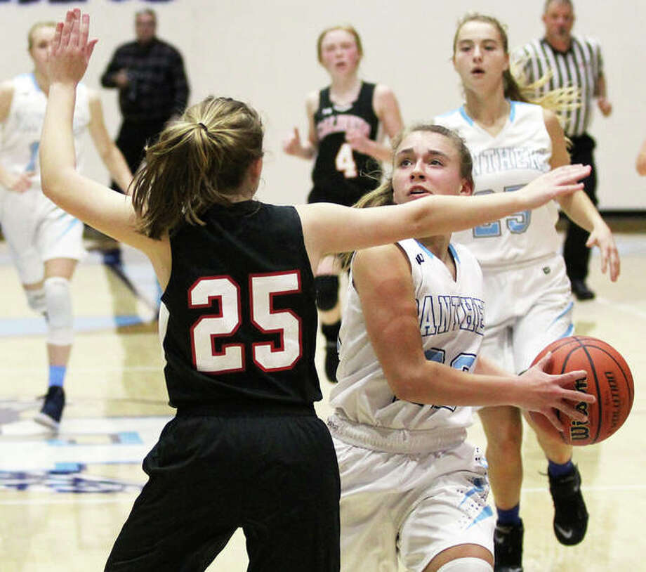 Jersey's Clare Breden's Panthers dropped a 56-53 decision to Springfield Sacred-Heart Griffin Thursday on a buzzer-beating 3-pointer by the Cyclones' Maggie Gilmore. Breden is shown in action earlier this season against Calhoun. Photo: Telegraph File Photo