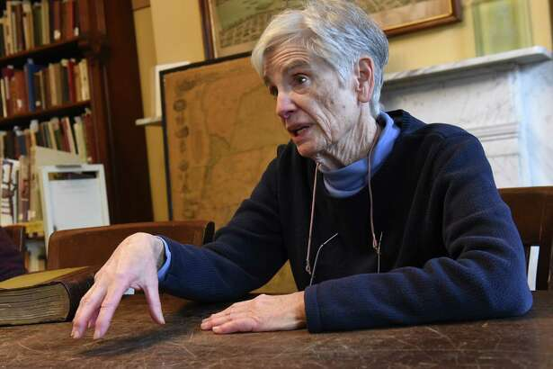 "Retired research librarian Elsa Prigozy is interviewed at Rensselaer County Historical Society on Friday Feb. 15, 2019 in Troy, N.Y. The 78-year-old Prigozy helped to identify men in the limited edition 19th century travel book ""Sport Among the Rockies"" by The Scribe. (Lori Van Buren/Times Union)"