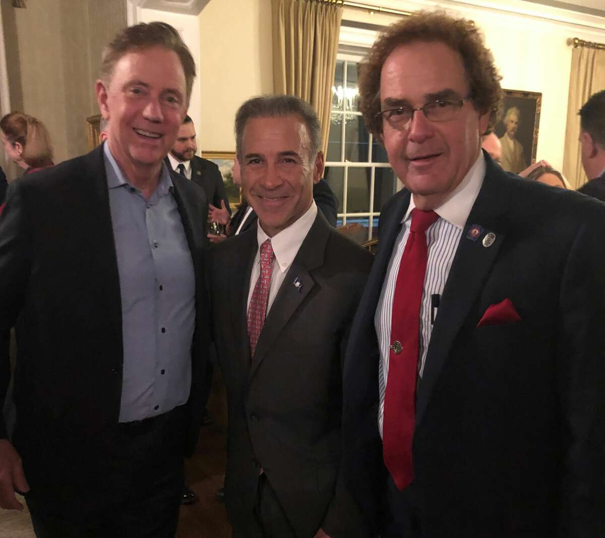Gov. Ned Lamont, state Rep. Fred Camillo, R-Greenwich, and state Rep. Tom Delinicki, R-South Windsor, posed at the Valentine's Day