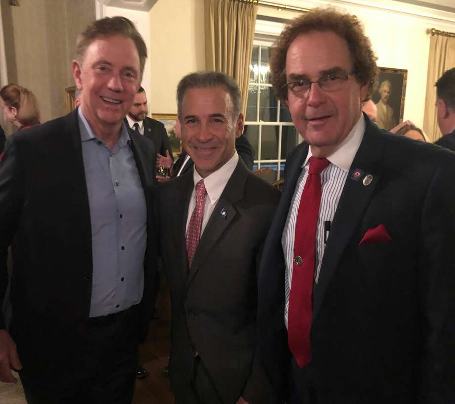 """Gov. Ned Lamont, state Rep. Fred Camillo, R-Greenwich, and state Rep. Tom Delinicki, R-South Windsor, posed at the Valentine's Day """"meet and greet"""" cocktail party for Republican legislators at the governor's residence in Hartford, Conn. on Thursday, February 14, 2019. Photo: Contributed"""