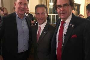 "Gov. Ned Lamont, state Rep. Fred Camillo, R-Greenwich, and state Rep. Tom Delinicki, R-South Windsor, posed at the Valentine's Day ""meet and greet"" cocktail party for Republican legislators at the governor's residence in Hartford, Conn. on Thursday, February 14, 2019."