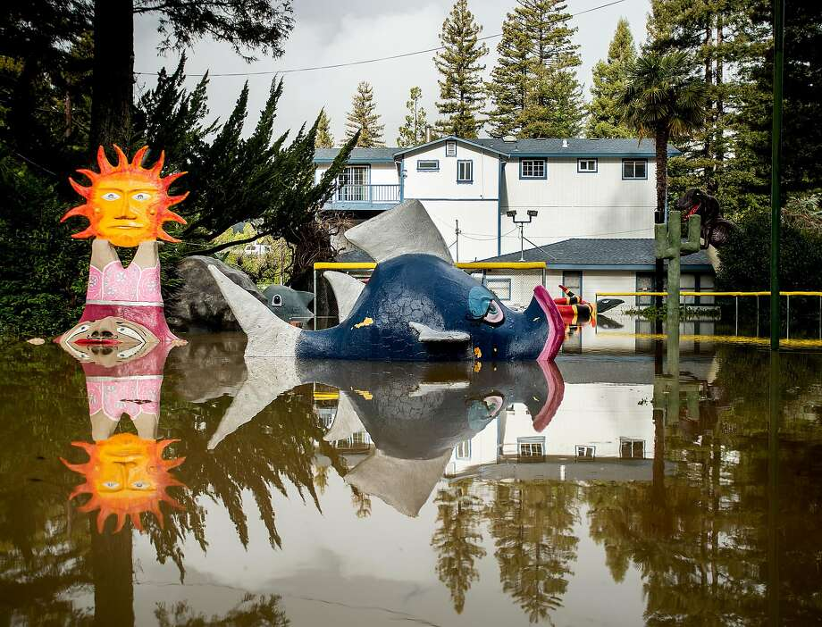 Flood waters surround miniature golf features at the shuttered Pee Wee Golf and Arcade in Guerneville, Calif., on Friday, Feb. 15, 2019. The Russian River overflowed its banks flooding some streets before waters started to recede Friday morning. Photo: Noah Berger / Special To The Chronicle