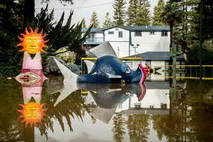 Flood waters surround miniature golf features at the shuttered Pee Wee Golf and Arcade in Guerneville, Calif., on Friday, Feb. 15, 2019. The Russian River overflowed its banks flooding some streets before waters started to recede Friday morning.