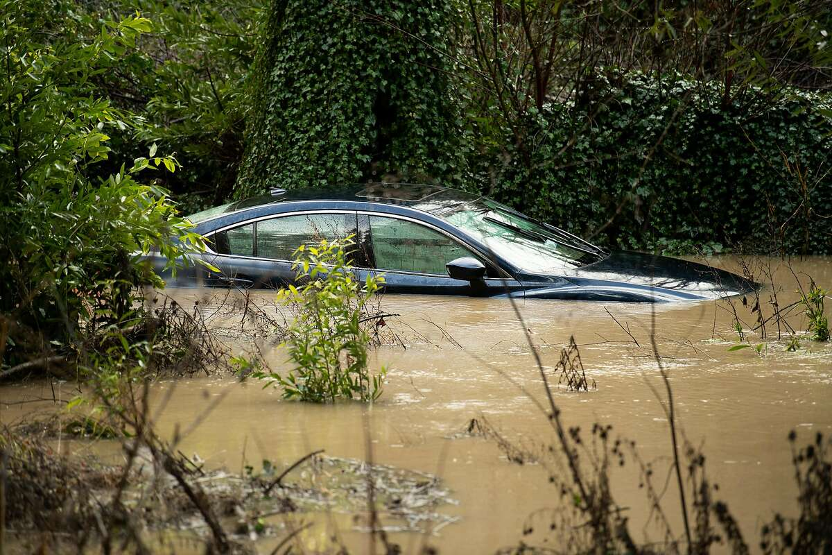 Flood waters from the Russian River surround a vehicle on Friday, Feb. 15, 2019, in Guerneville, Calif.