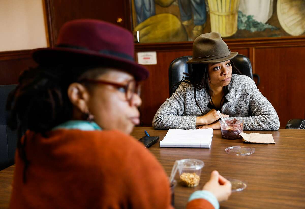 Melorra Green (left) and her twin sister Melonie Green (right), who are co-executive directors of the African-American Art and Culture Complex lead a meeting at AAACC in San Francisco, California, on Monday, Feb. 11, 2019. The Green twins work as curators, artists, radio show hosts and community activists throughout the Bay Area.