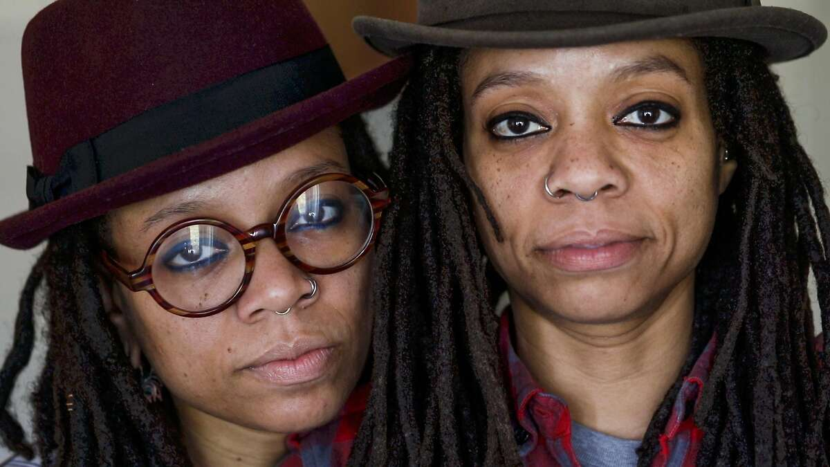 Melorra Green (left) and her twin sister Melonie Green (right), pose for a portrait in their home in San Francisco, California, on Tuesday, Feb. 12, 2019. The Green twins work as curators, artists, radio show hosts and community activists throughout the Bay Area.