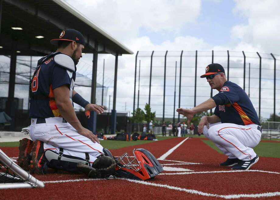 PHOTOS: Houston Astros top prospects in 2019  Houston Astros catcher Robinson Chirinos, left, has a one-on-one session with manager AJ Hinch, who used to play cather, at Fitteam Ballpark of The Palm Beaches on Day 1 of spring training on Thursday, Feb. 14, 2019, in West Palm Beach. >>>See the Houston Astros' top prospects heading into the 2019 season ...  Photo: Yi-Chin Lee, Staff / Houston Chronicle / © 2019 Houston Chronicle