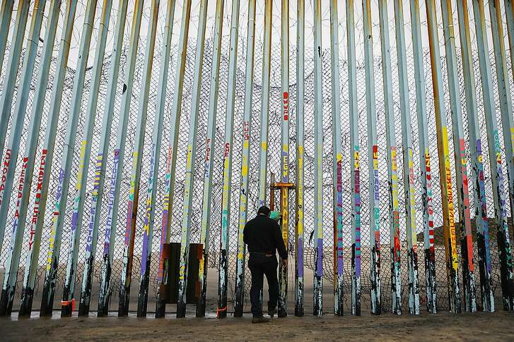 TIJUANA, MEXICO - FEBRUARY 15:  A man stands at the U.S.-Mexico border barrier on February 15, 2019 in Tijuana, Mexico. President Trump has declared a national emergency which will bypass Congress to fund his proposed border wall. (Photo by Mario Tama/Getty Images)