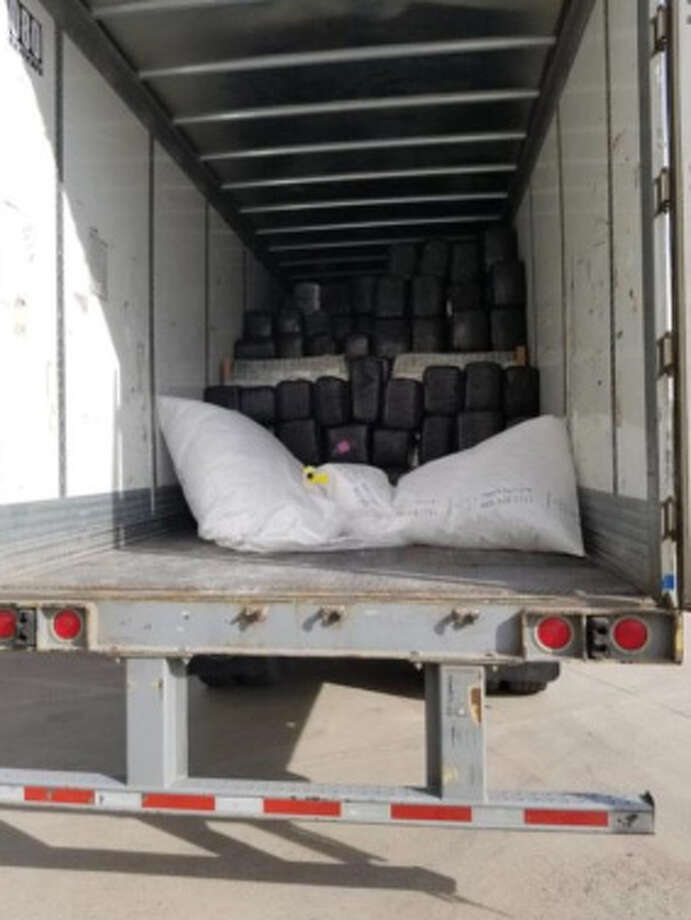 Laredo police said they seized about 14,176 pounds of marijuana with an estimated street value of $11,340,800 following a traffic violation in the 19000 block of FM 1472. Photo: Laredo Police Department