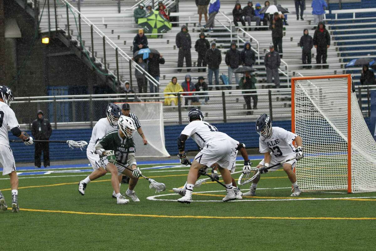 Goalie Jack Starr (23) and the Yale men's lacrosse team face Georgetown on Saturday in the opening round of the NCAA tournament.