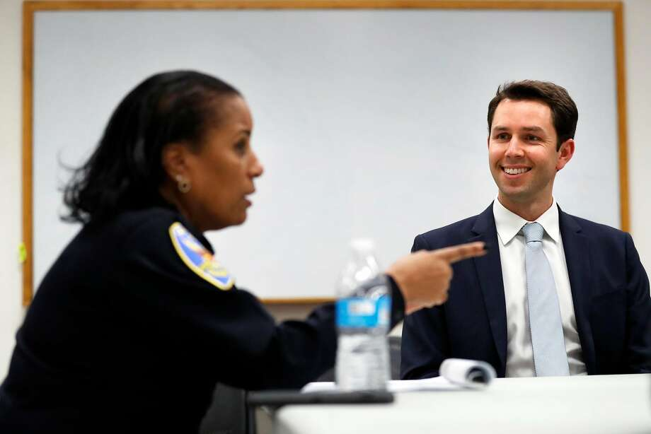 Leif Dautch (right) listens to Capt. Valerie Matthews at a monthly community meeting at SFPD Bayview headquarters. Photo: Scott Strazzante / The Chronicle