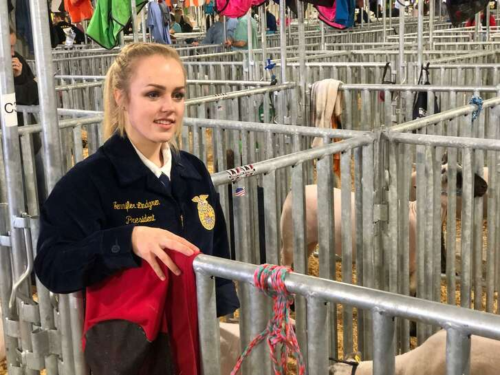 """Jennifer Lindgren, 17, a senior at Cinco Ranch High, was born with only one hand but that hasn't slowed her down a bit. She's president of the school's FFA chapter and is showing her lamb called """"Loo"""" at this year's Katy FFA Livestock Show & Rodeo."""