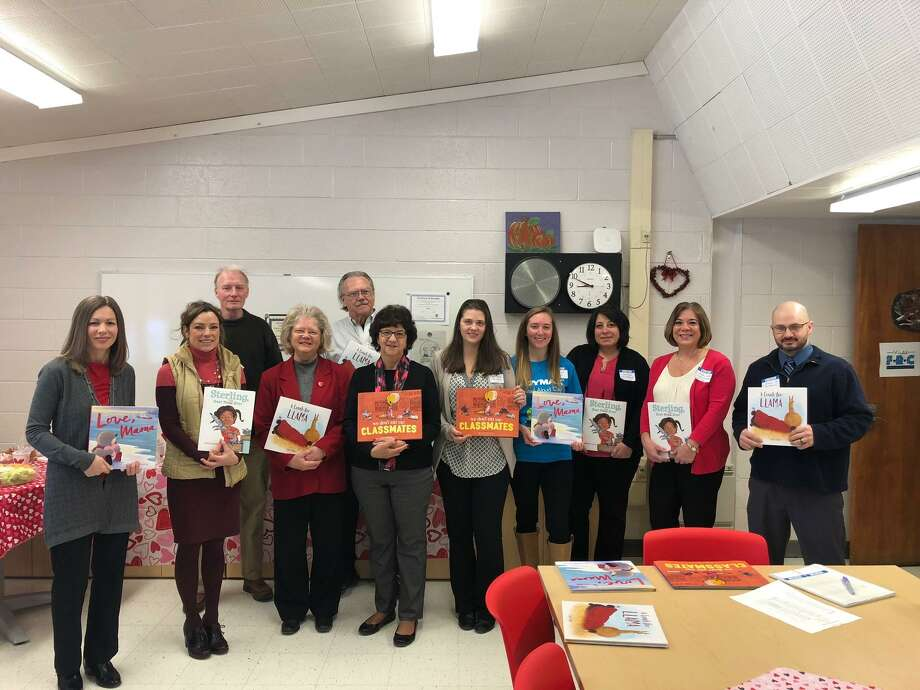 The Northwest Connecticut Chamber of Commerce hosted its annual Read Aloud Day on Wednesday and Thursday, Feb. 13-14, at elementary schools around the region. Above, a group of volunteers show their books before heading to classrooms to read at Batcheller Elementary School in Winsted. Photo: Contributed Photo /