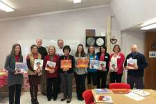 The Northwest Connecticut Chamber of Commerce hosted its annual Read Aloud Day on Wednesday and Thursday, Feb. 13-14, at elementary schools around the region. Above, a group of volunteers show their books before heading to classrooms to read at Batcheller Elementary School in Winsted.