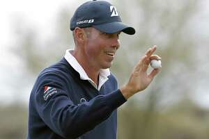 Matt Kuchar waves after making his birdie putt on the 12th green during the third round of the Phoenix Open PGA golf tournament, Feb. 2, 2019, in Scottsdale, Ariz.
