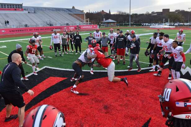 Players go through drills during spring football practice for the University of the Incarnate Word at Benson Stadium.