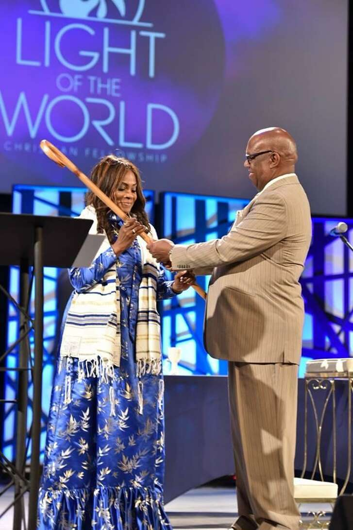 Pastor Jerry Martin (right) at the installation ceremony of his wife Jackie, who also holds the same position, at the Light of the World Christian Fellowshipin Humble, Texas.