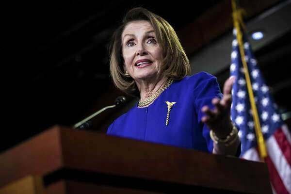 """U.S. House Speaker Nancy Pelosi, a Democrat from California, speaks during a news conference on Capitol Hill in Washington, D.C., U.S., on Thursday, Feb. 7, 2019. Pelosi told reporters that House Democrats plan to mark up legislation that will address """"the proliferation of guns' in the U.S. and was disappointed President Trump didn't mention the issue in his State of the Union address this week. Photographer: Al Drago/Bloomberg"""