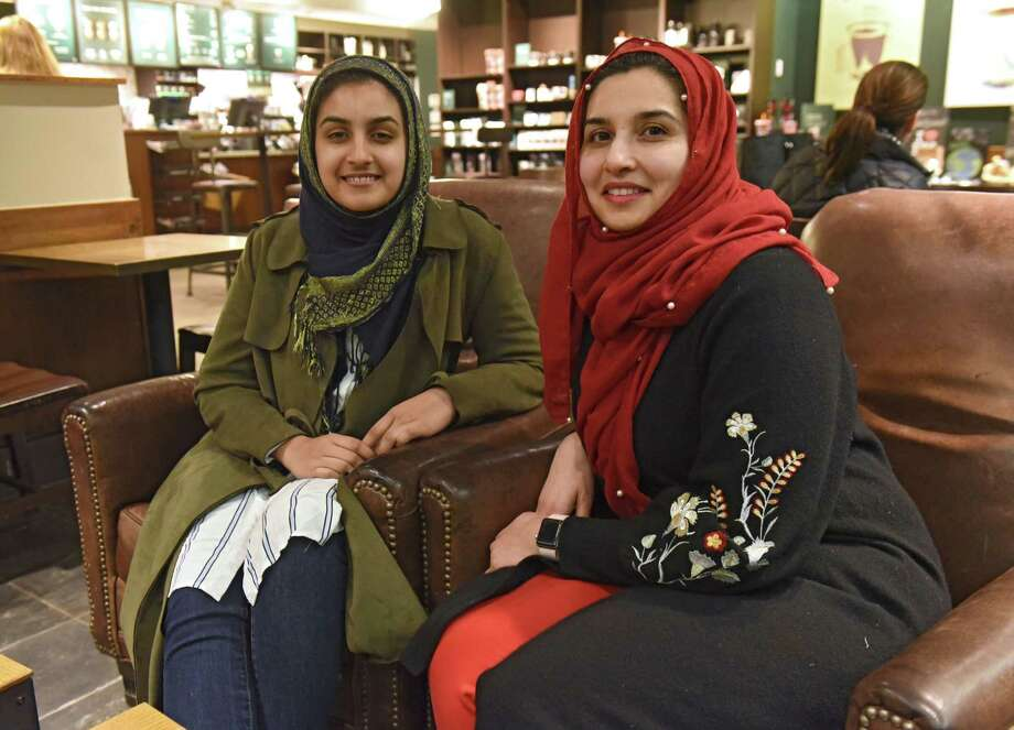 Samin Khan, right, sits with her daughter Elham in a coffee shop on Thursday, Feb. 14, 2019 in Colonie, N.Y. They wanted to do an interfaith project for Valentine's Day that honored the meaning of true love or true friendship. (Lori Van Buren/Times Union) Photo: Lori Van Buren / 40046212A