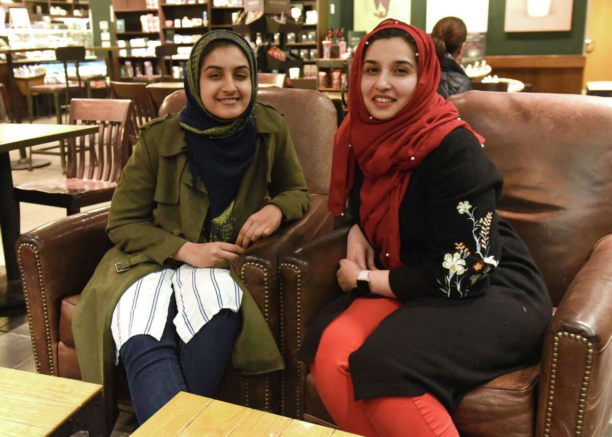 Samin Khan, right, sits with her daughter Elham in a coffee shop on Thursday, Feb. 14, 2019 in Colonie, N.Y. They wanted to do an interfaith project for Valentine's Day that honored the meaning of true love or true friendship. (Lori Van Buren/Times Union)