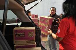 Daisy Troop Leader Alexa Dombkowski had her vehicle filled with about 100 cases of Girl Scout cookies, including the ever-popular Caramel deLites, at Rhodes Stadium in Katy on Feb. 14.