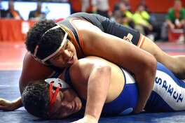 Edwardsville heavyweight Lloyd Reynolds take down Mount Prospect's Josh Ramos during a second-round consolation match Friday. EHS wrestling at state