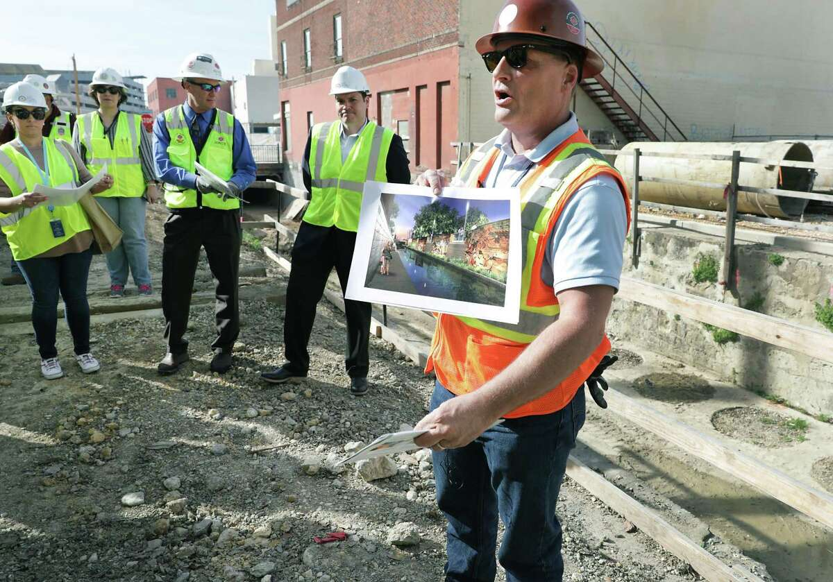 Kerry Averyt, the project manager with the San Antonio River Authority, gives a tour of the construction of the second segment of the San Pedro Creek Culture Park on Feb. 15, 2019.
