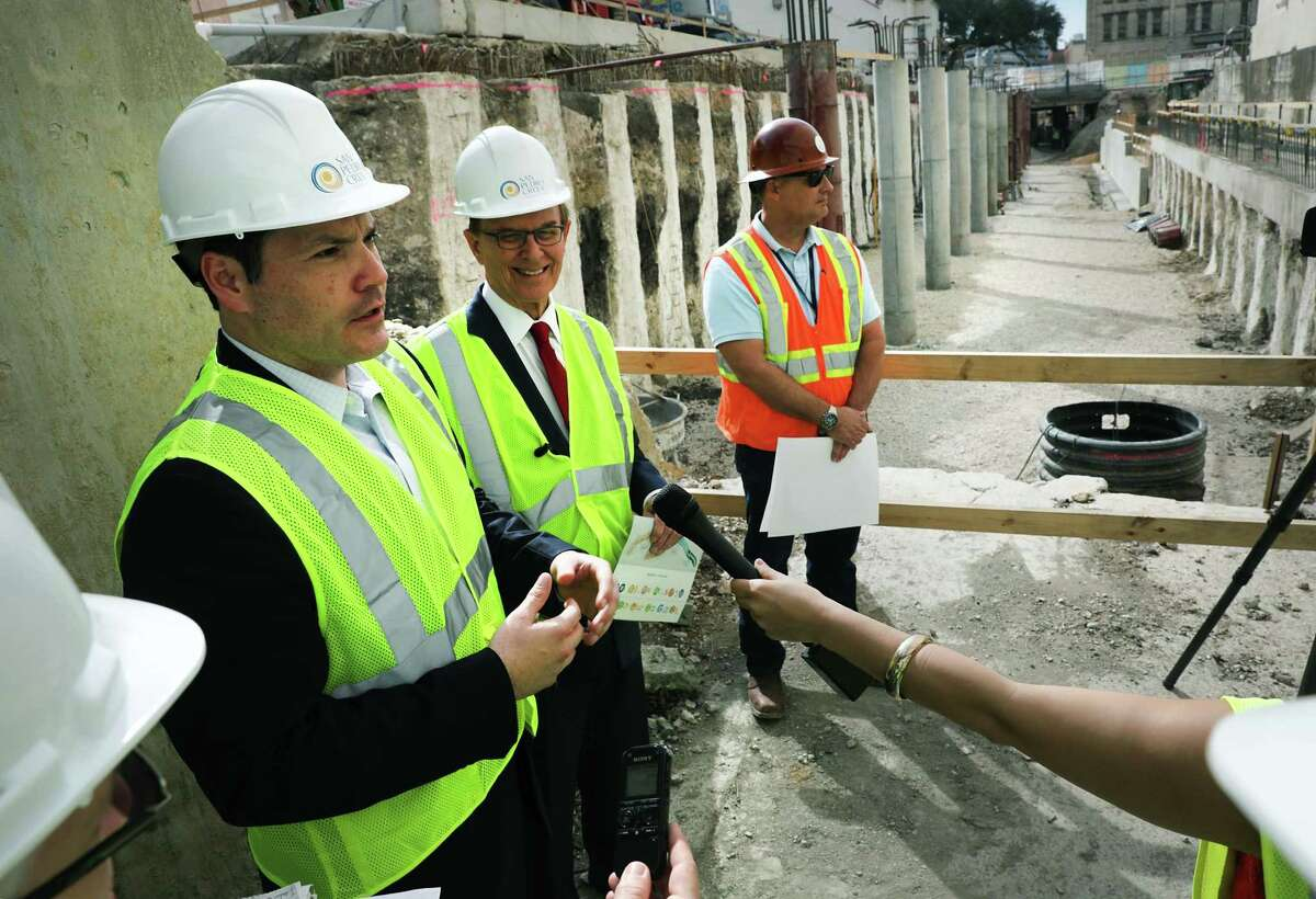 Bexar County Commissioner Justin Rodriguez, left, and Judge Nelson Wolff, center, go on a tour to see current construction of the second segment of the San Pedro Creek Culture Park, on Friday, Feb. 15, 2019.