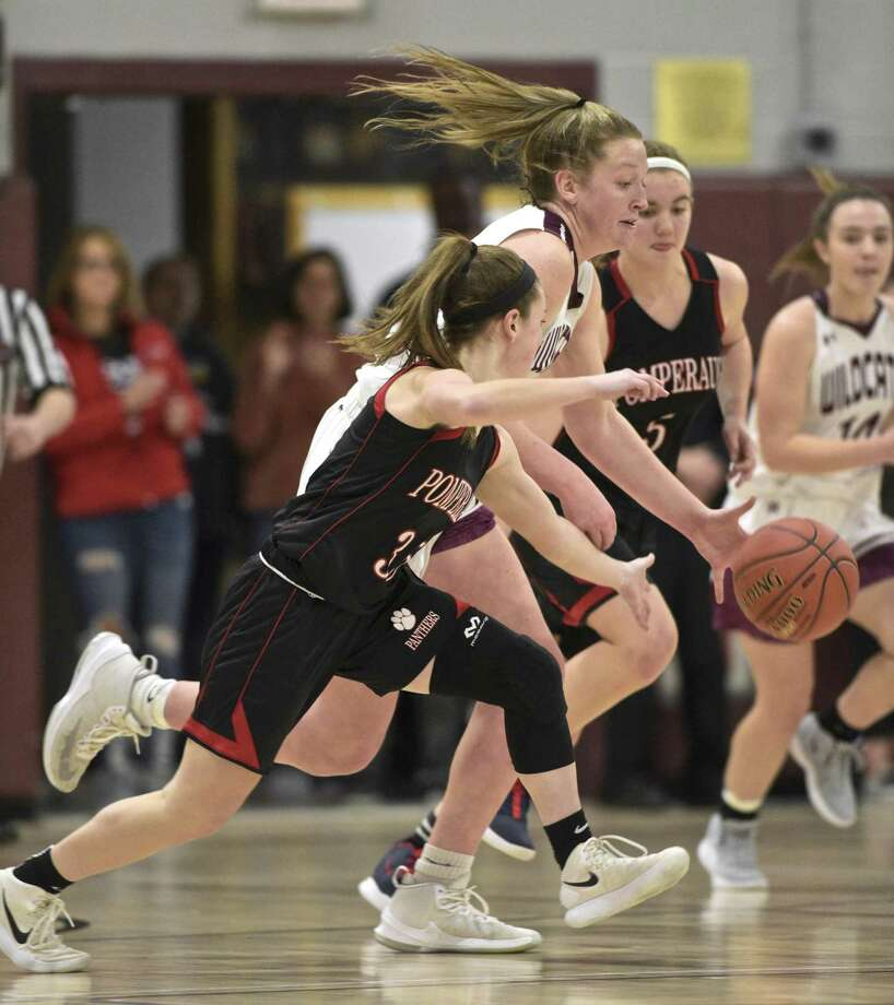 Bethel's Maranda Nyborg (30) drives past Pomperaug's Madison Villa (35) in the SWC girls basketball tournament quarterfinal game against Pomperaug on Friday at Bethel High School. Photo: H John Voorhees III / Hearst Connecticut Media / The News-Times