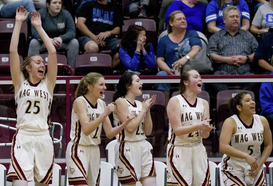 Magnolia West players react to a three-pointer during the second quarter of a Region III-5A high school area basketball playoff game at Hearne High School, Friday, Feb. 15, 2019, in Hearne. Photo: Jason Fochtman, Houston Chronicle / Staff Photographer / © 2019 Houston Chronicle