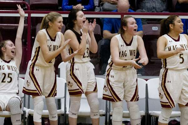 Magnolia West players react after a three-pointer during the second quarter of a Region III-5A high school area basketball playoff game at Hearne High School, Friday, Feb. 15, 2019, in Hearne.