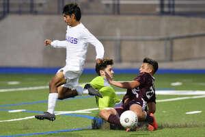 Midland High's Freddy Lopez (2) jumps by as keeper Noah Venegas stops an attack from Lee's Jacob Maltos (22) Feb. 15, 2019, at Grande Communications Stadium. James Durbin/Reporter-Telegram
