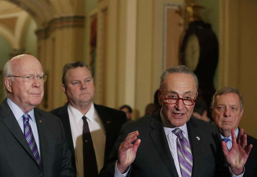 WASHINGTON, DC - FEBRUARY 12: Senate Minority Leader Chuck Schumer (D-NY) speaks about a bipartisan border security compromise negotiated by congressional leaders as Sen. Patrick Leahy (D-VT), Sen. Jon Tester (D-MT) and Sen. Richard Durbin (D-IL) listen on February 12, 2019 in Washington, DC. (Photo by Mark Wilson/Getty Images)