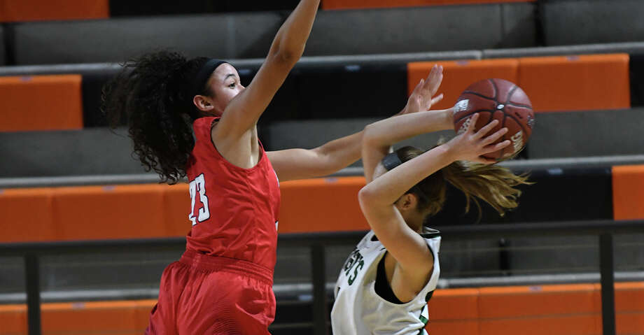 Atascocita junior post Kyleigh McGuire, left, skies for a block against Clear Falls senior forward Piper Stephenson during the 1st quarter of their Region III-6A Area Championship matchup at La Porte High School on Feb. 15, 2019. Photo: Jerry Baker/Contributor
