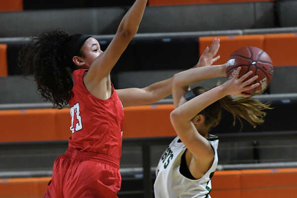 Atascocita junior post Kyleigh McGuire, left, skies for a block against Clear Falls senior forward Piper Stephenson during the 1st quarter of their Region III-6A Area Championship matchup at La Porte High School on Feb. 15, 2019.